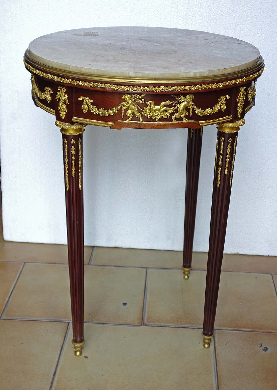 A French Louis Xvi Style Gany And Gilt Bronze Round Table With Marble Top